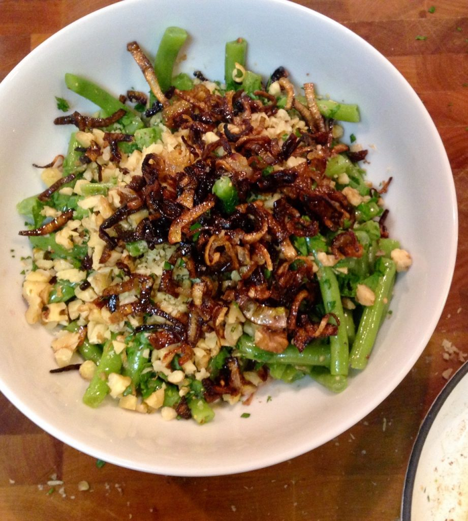 fancy green beans made with vinaigrette, toasted walnuts and fried shallots