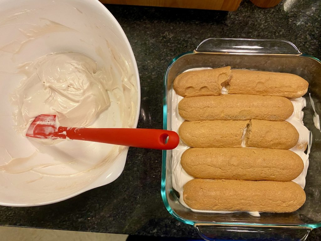 Ladyfingers dipped in espresso and layered in a baking dish, layer with half of the cream mixture, then repeat.