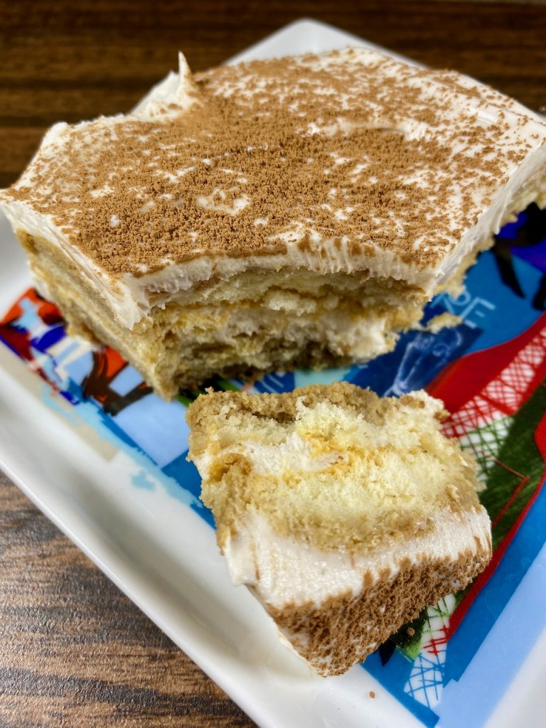 Simple and delicious tiramisu made with Schär gluten-free ladyfingers, instant espresso, Kite Hill dairy-free cream cheese, So delicious dairy-free coconut whipped cream, and powdered cocoa.