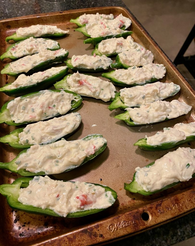 Stuff jalapeños with crab cream cheese mixture