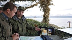Russian soldiers discuss the Kuril Island's new defensive perimeters for Russian Prime Minister Dmitri Medvedev.