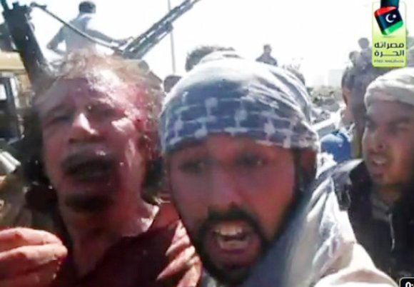 Muammar Gaddafi's last moments before being executed by Libyan rebels.