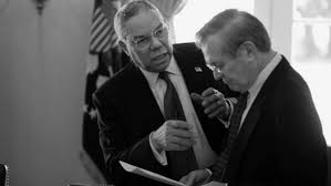 Secretary of State Powell and Secretary of Defense Rumsfeld share a particularly contentious conversation over the Iraq War.
