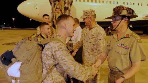 """In 2010, the Obama Administration announced that the northern Australian military base in Darwin would see the permanent deployment of roughly 200 United States Marines as part of the Obama Administration's """"Asia Pivot."""" This photo is of the first U.S. Marines arriving at Darwin, being greeted by their Australian counterparts."""