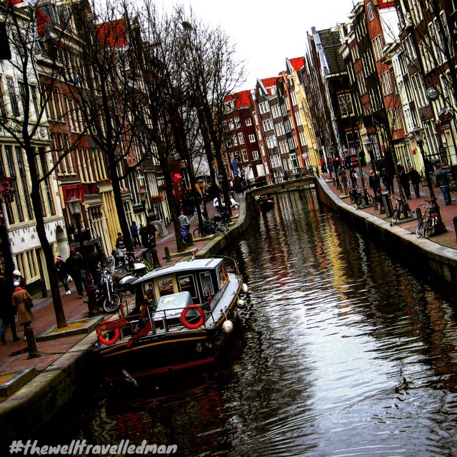 thewelltravelledman travel blog amsterdam netherlands canal and houses