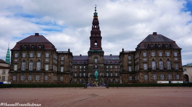 Christiansborg Palace - a palace and government building on the islet of Slotsholmen in central Copenhagen. It is the seat of the Danish Parliament, the Danish Prime Minister's Office and the Supreme Court of Denmark