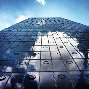 Clouds reflected in the office building