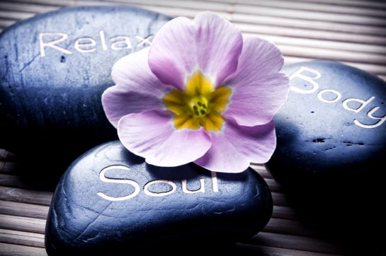 Healing energies, the link between a hot stone massage and Hawaii