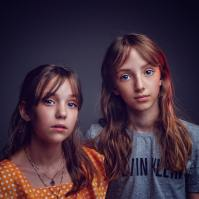 Two average pre-teen girls with stunning blue eyes
