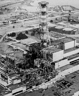 An aerial view of the Chernobyl nucler power plant, the site of the world's worst nuclear accident, is seen in April 1986, made two to three days after the explosion in Chernobyl, Ukraine. In front of the chimney is the destroyed 4th reactor. (AP Photo)