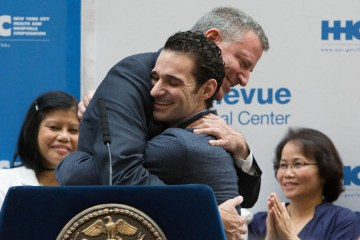 Dr Craig Spencer hugging New York City Mayor after being discharged from hospital