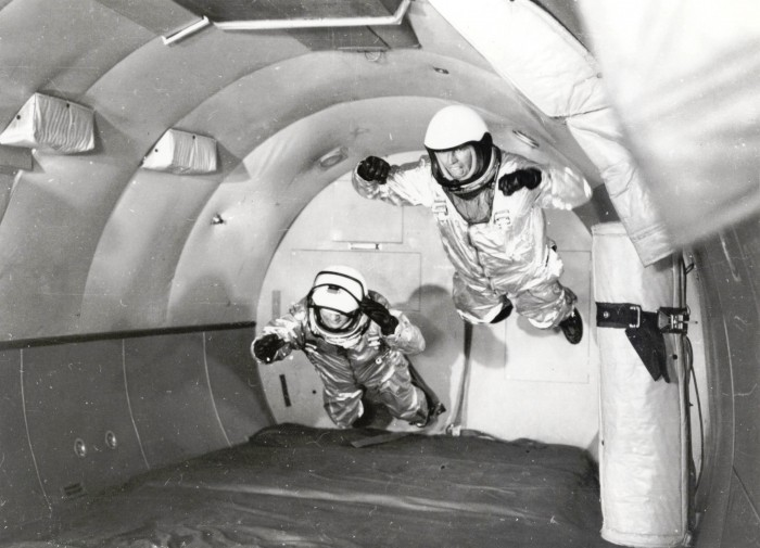 """Mercury Astronauts in Weightless Flight on C-131 Aircraft Full Description: Astronauts in simulated weightless flight in C-131 aircraft flying """"zero-g"""" trajectory at Wright Air Development Center. Weightless flights were a new form of training for the Mercury astronauts and parabolic flights that briefly go beyond the Earth's tug of gravity continue to be used for spaceflight training purposes. These flights are nicknamed the """"vomit comet"""" because of the nausea that is often induced. Date: 1959 http://www.nasaimages.org/luna/servlet/detail/nasaNAS~5~5~21814~126539:Mercury-Astronauts-in-Weightless-Fl"""