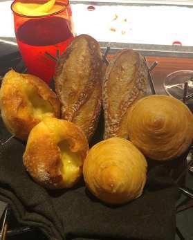 crisp mini-baguette, flaky escargot roll, and decadent comté cheese bread