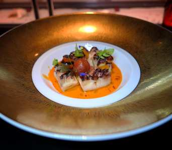Le Poulpe: grilled mediterranean octopus, confit peppers, carrot harissa sauce