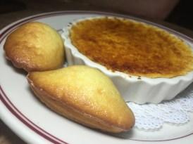 Vanilla Bean Creme Brûlée served with a warm madeleine