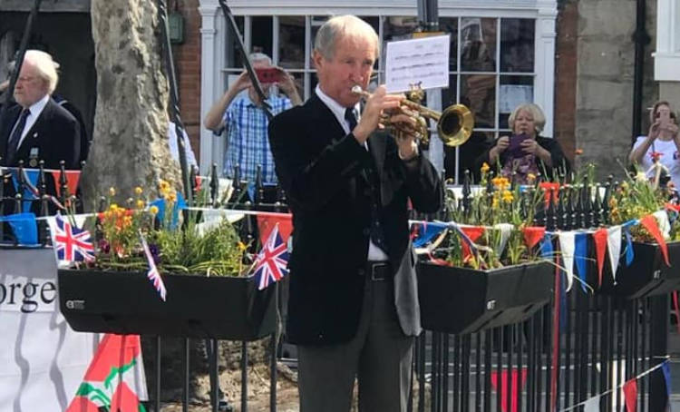 The lone trumpeter diring a poignant VE Day celebration moment