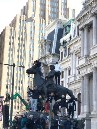 No statue was safe from climbers, even the ones outside City Hall. -Photo courtesy of Joe Merkle
