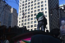 A single fan stands atop a tall structure to get a better view of the parade. -Copy Editor/Grace Clevenger