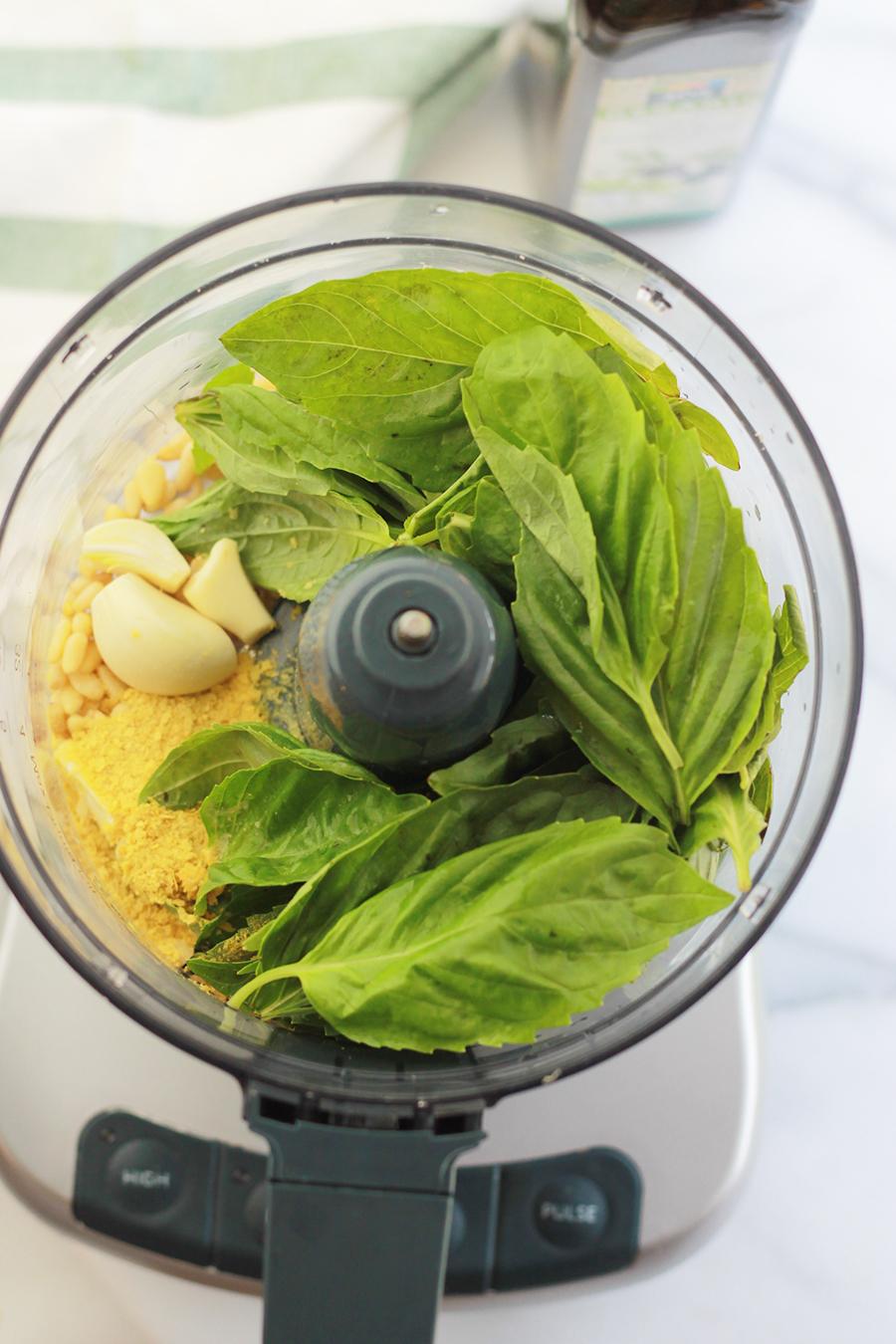 Vegan pesto ingredients in food processor.