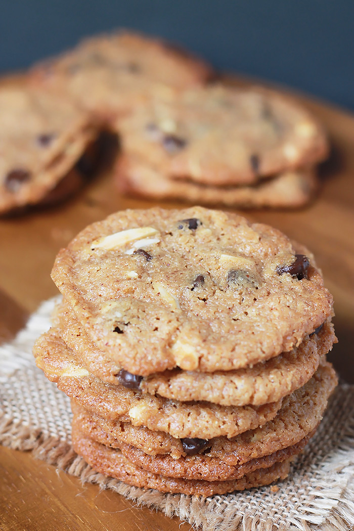 AlVegan Almond Butter Chocolate Chip Cookies, thin, crispy, chewy cookies made with almond butter and studded with slivered almonds and dark chocolate chops!