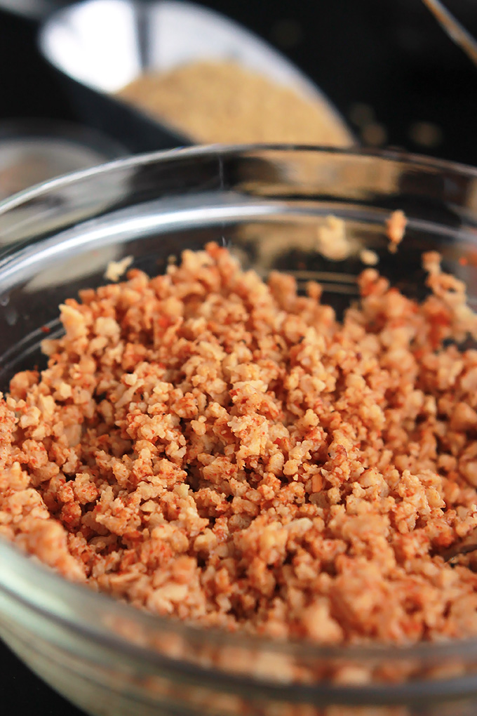 Close-up of hydrated textured vegetable protein in a glass bowl.
