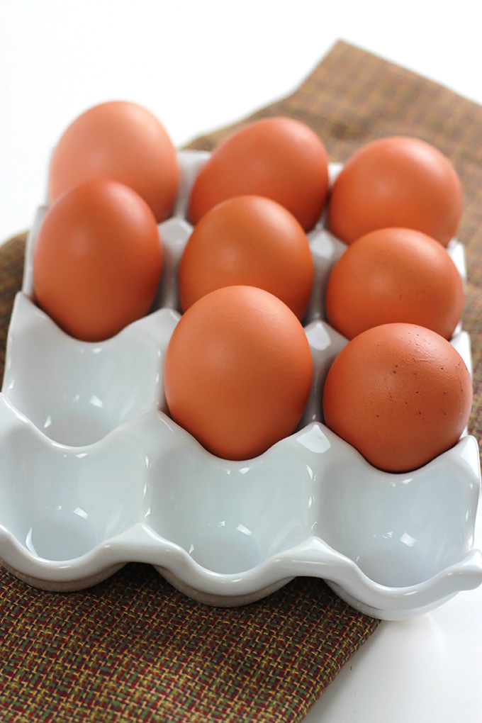 Brown eggs on an egg dish.