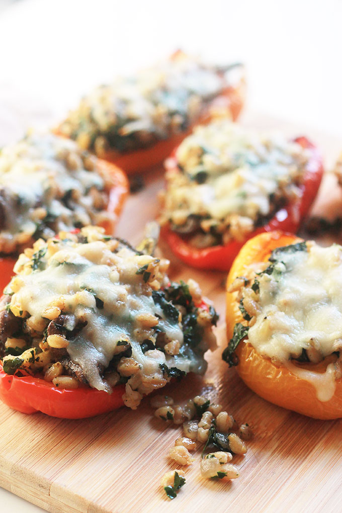 Kale & Farro Stuffed Peppers-Packed full of nutritious farro filled with protein and fiber. Perfect weeknight dinner with a large green salad.