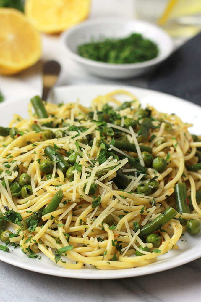 Fresh mix of herbs over crisp veggies and tender pasta finished off with a squeeze of lemon juice, this Herb Green Bean and Pea Pasta sings spring.
