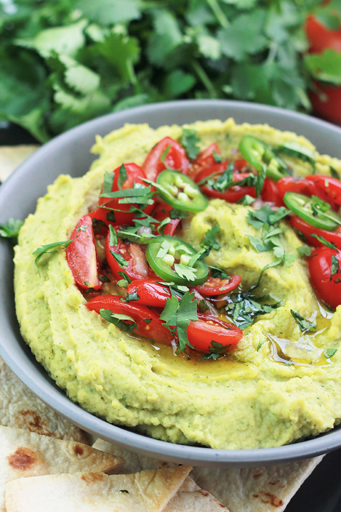 This quick and easy Cilantro Jalapeno Hummus is a wonderful combination of flavors. A take off the traditional hummus recipe, but spiced-up a bit.