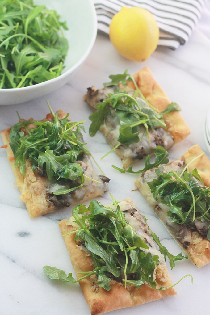 Slices of Mushroom Pizza with Artichoke Pesto and Arugula-Rich, aromatic, and filled with incredible flavor.