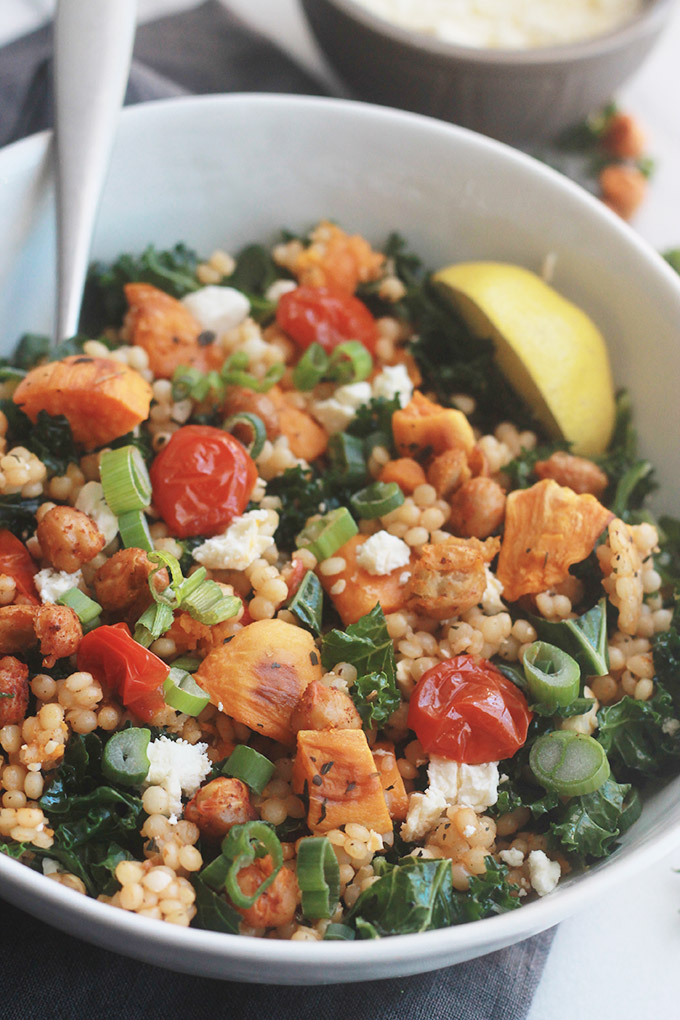 Ready for a supercharged, healthy, hearty salad?  You're going to love this Israeli Couscous Kale Salad with Feta it's made with tender Israeli Couscous, roasted tomatoes, sweet potatoes and chickpeas tossed with seasoned fresh kale.