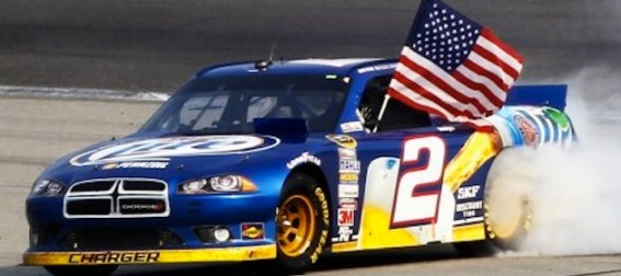 brad-keselowski-waves-american-flag-and-celebrates-victory