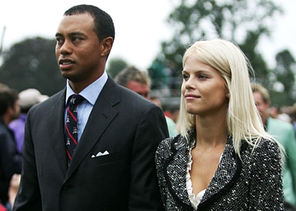 KILDARE, IRELAND - SEPTEMBER 21: Tiger Woods and his wife Elin look on during the Opening Ceremony of the 2006 Ryder Cup at The K Club on September 21, 2006 in Straffan, Co. Kildare, Ireland. (Photo by Harry How/Getty Images)