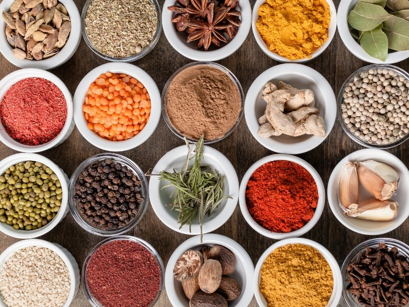 Various herbs and spices in small pinch bowls