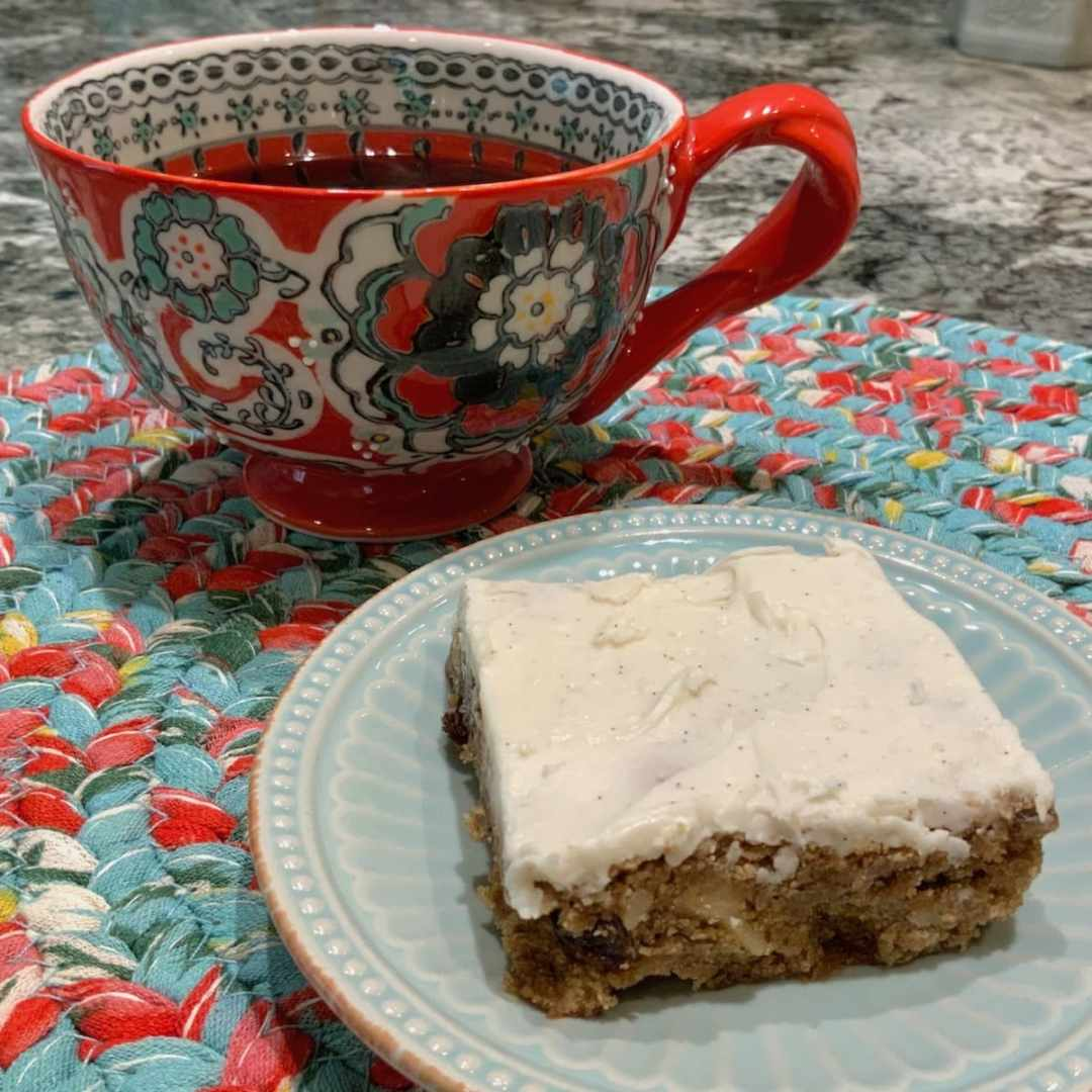 Hermit Bars with Vanilla Icing served with a cup of coffee