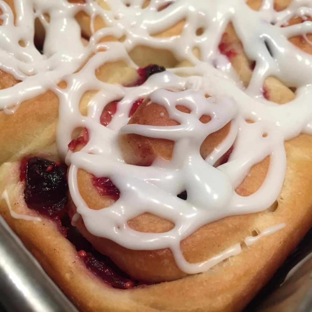 Closeup of Cranberry Orange Sweet Rolls with Icing