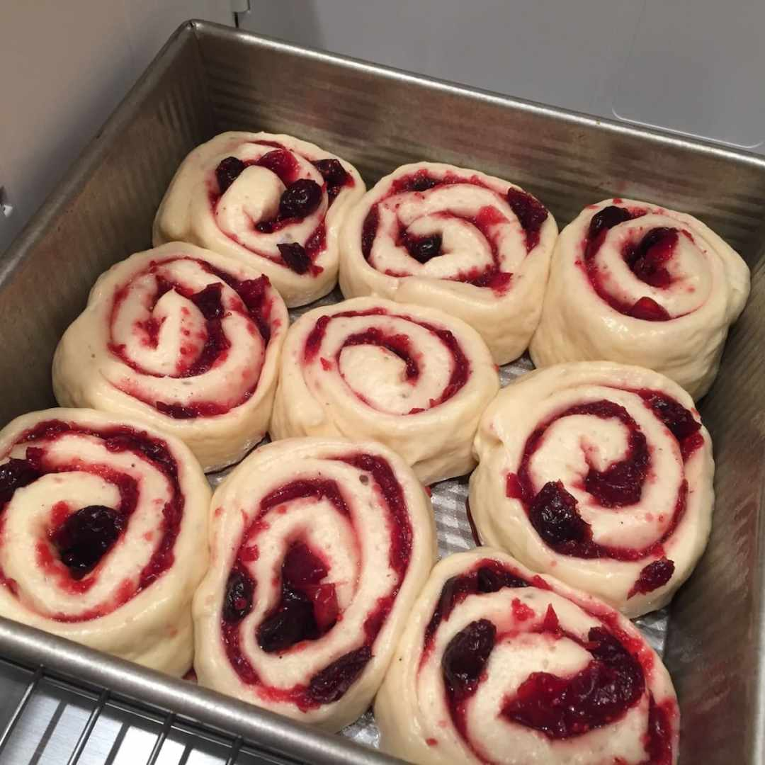 Cranberry Orange Sweet Rolls rising in their baking pan