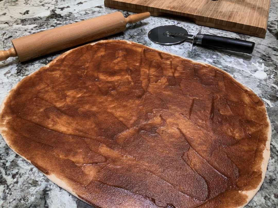 Cinnamon filling spread over dough for Cinnamon Pull-Apart Bread