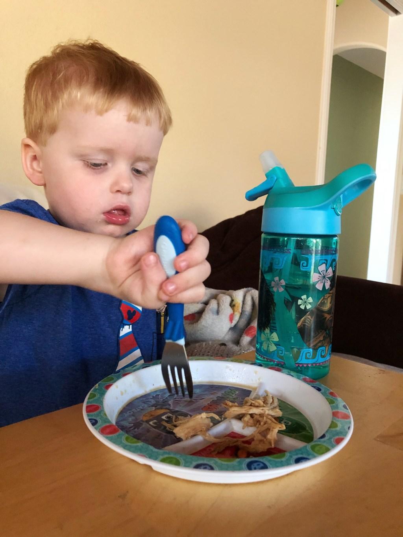 Child Enjoying Instant Pot Hawaiian Kalua Chicken