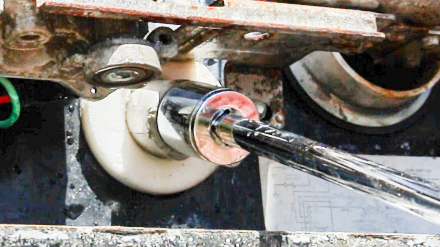 Tightening the anode into the RV water heater drain after the flush