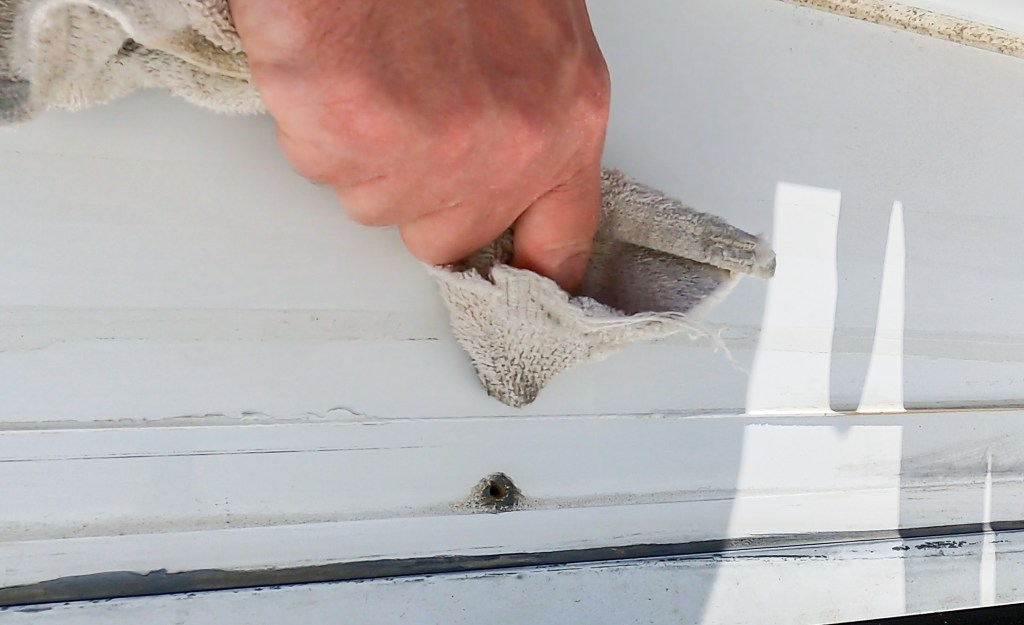 Prepare the surface for new sealant with acetone and a white rag