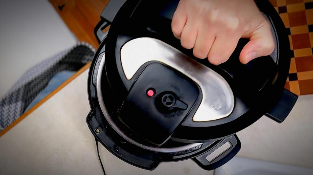 putting on the instant pot lid