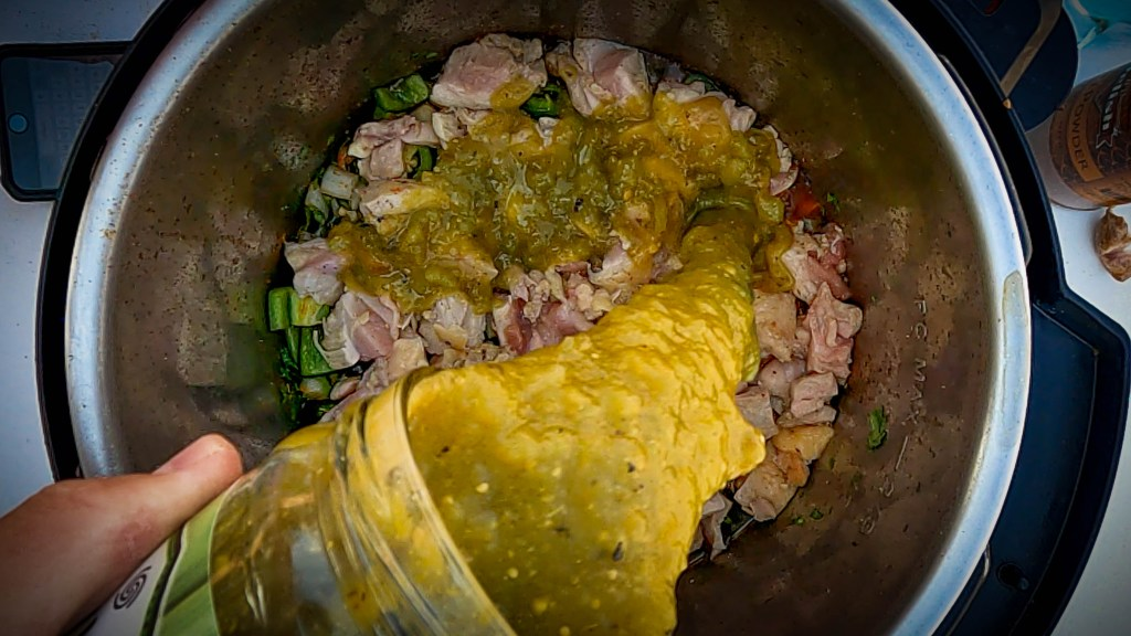 Add 28 - 32 ounces of your favorite salsa verde on top of the chicken pieces in the instant pot