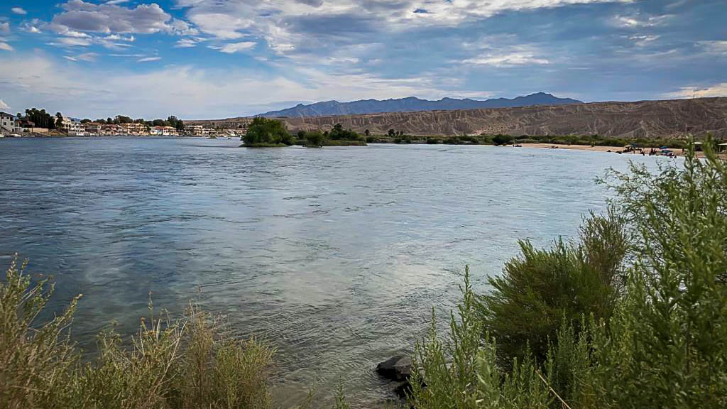 The Colorado River looking southeast.  Arizona has houses on the river.  Swimming lagoon on the right
