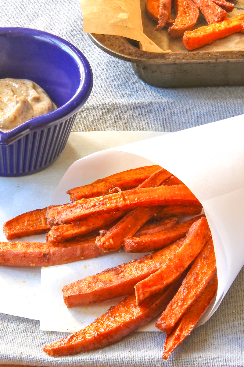 Roasted sweet potato 'fries' rubbed with spices, served with a maple-mustard dip.