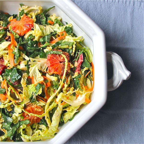 Asian winter salad of kale and cabbage and blood oranges with tahini miso ginger dressing