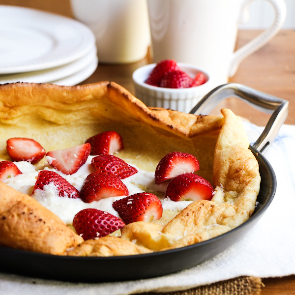 Dutch Baby Pancakes with Strawberries and sweetened ricotta cream