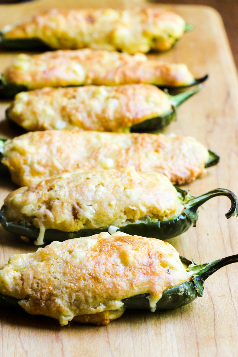 Jalapeño halves are filled with cornbread for a perfect party appetizer.