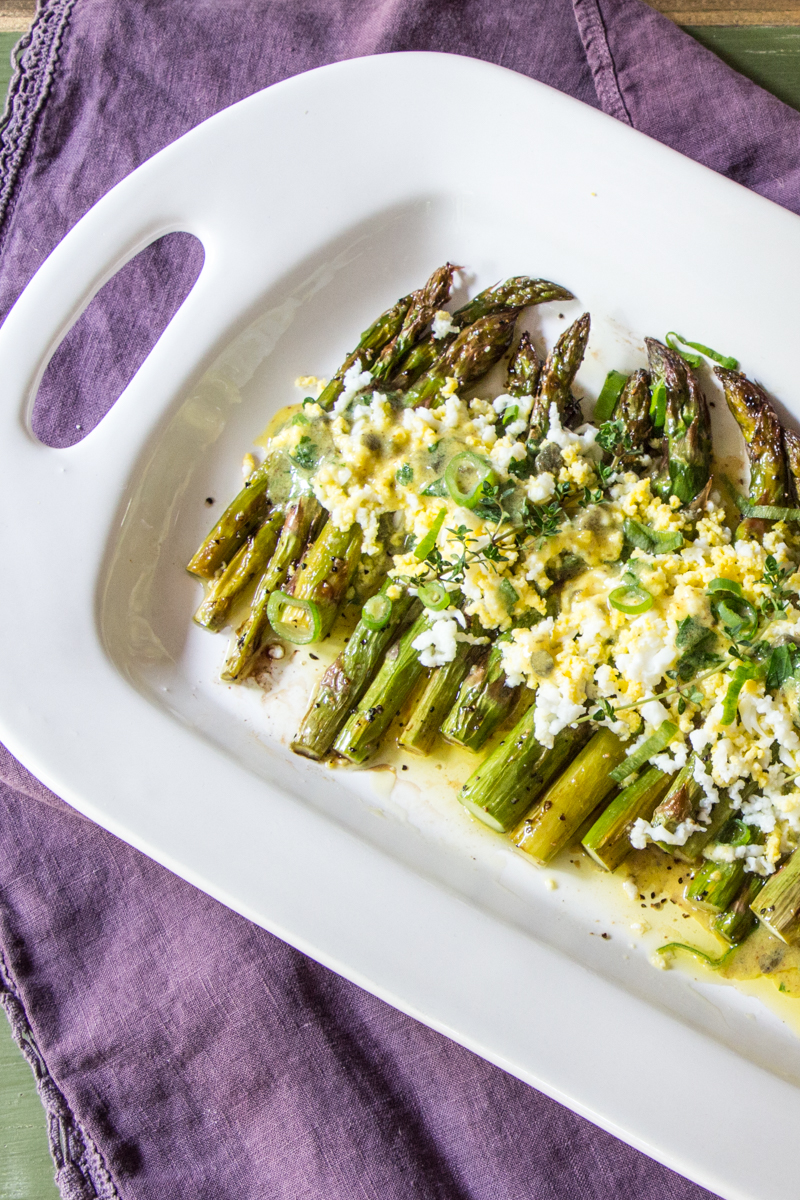 Roasted asparagus topped with chopped hard boiled eggs, and dressing in a gribiche dressing of capers, egg, mustard, and garlic.