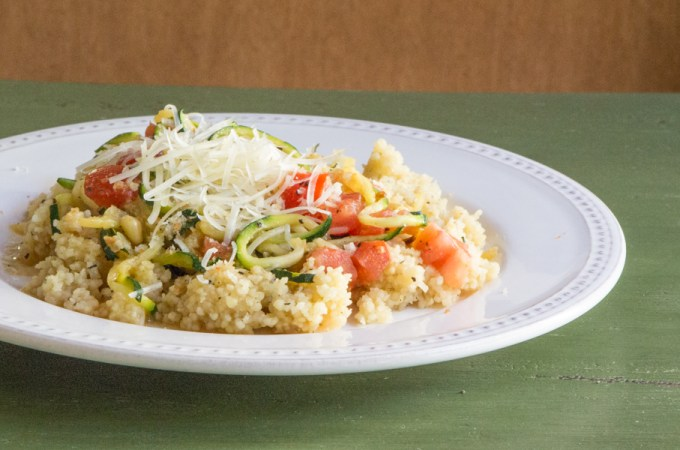 Spiralized zucchini cooked in a scampi sauce and served over couscous.